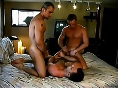 Three lustful guys get together on the bed for a torrid gay experience