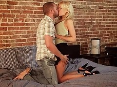 A big titted blonde enjoys licking his cock then getting drilled by it