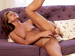 Slim and fit milf fingers her hairy pussy