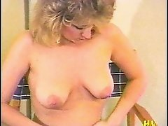 Masturbating solo babe teases her hairy pussy using a vibrator in close up